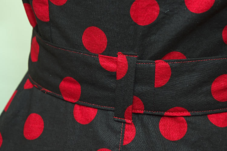 Black dress with red polka dots, back