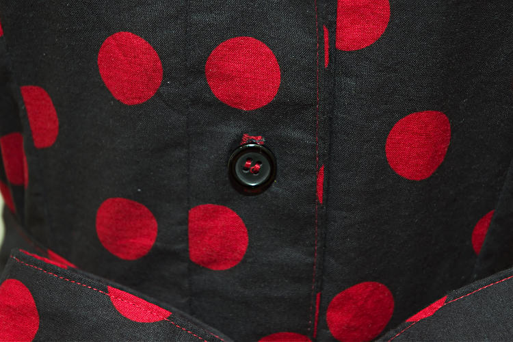 Black dress with red polka dots, closeup